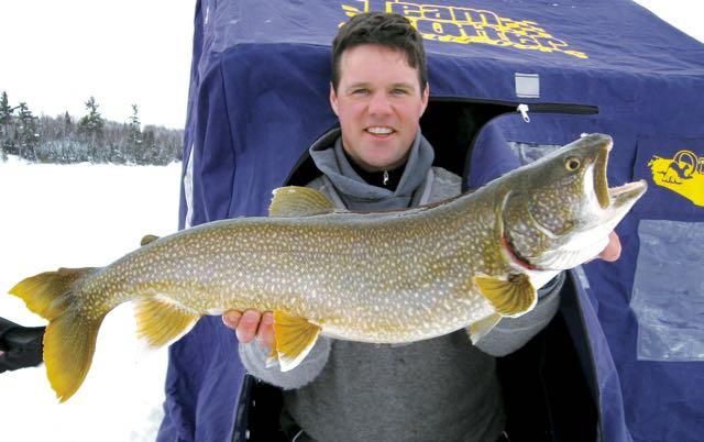 The author and Ryan Haines (above) refined a tube jig pattern to catch lunker lake trout. Credit: Gord Pyzer.