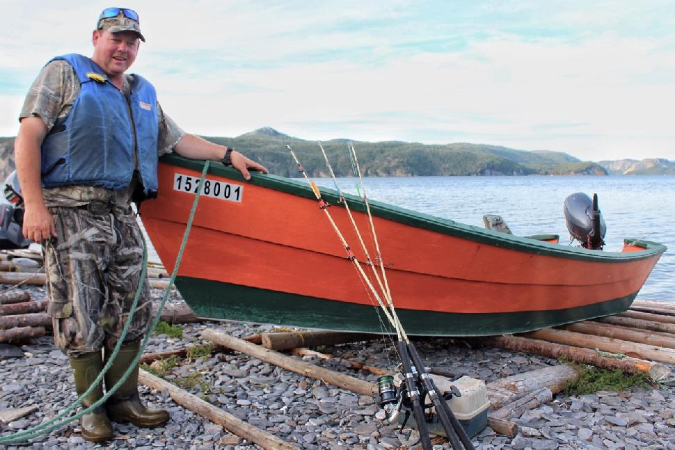 Four Season Tours owner Darren Park with a traditional dory. Credit: Darcy Rhyno.