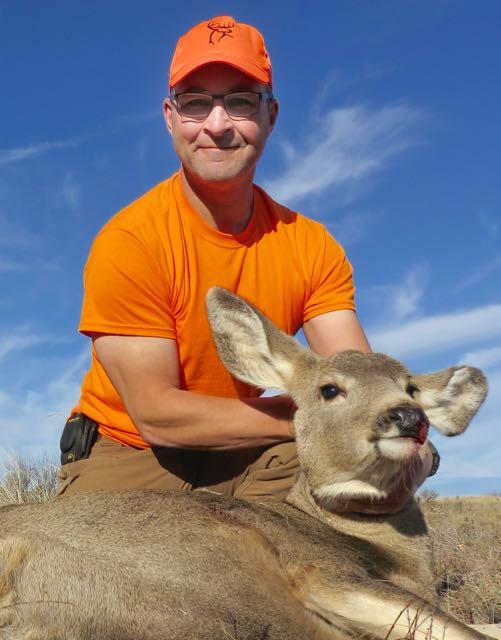 The author with a cleanly killed doe for the freezer. Credit: Lowell Strauss.