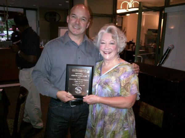 Plaque presentation: Yours truly receives his OWC award from the organization's awards chair, Adrienne Radford