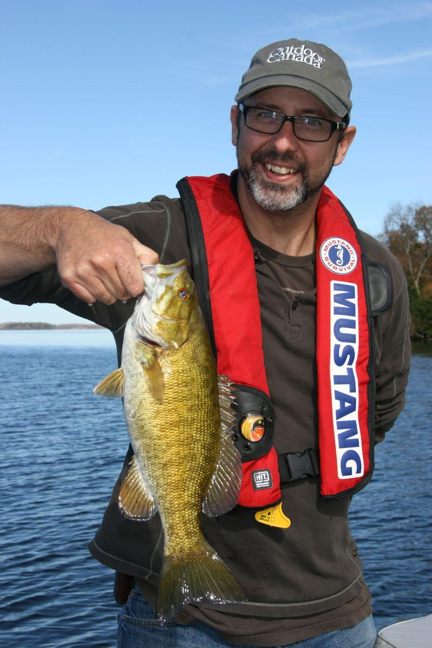 Bass happy: Outdoor Canada managing editor Bob Sexton and one of his catches