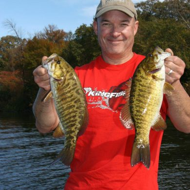 Fall smallies: Outdoor Canada editor Patrick Walsh and a couple of colourful Rice Lake tigers