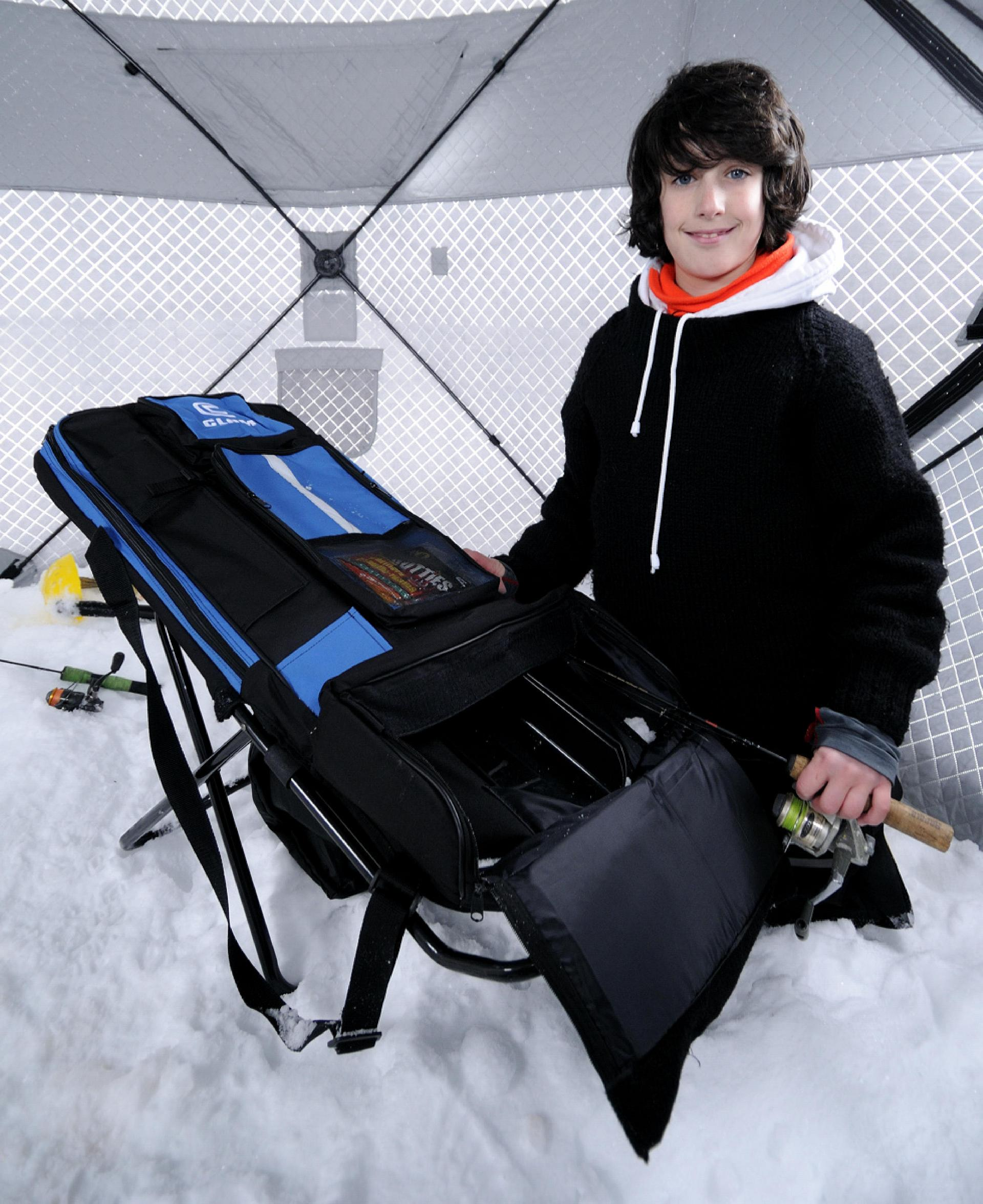 The Chair stores and protects six ice combos, with long accessory compartments for tip-ups. And it's comfy.