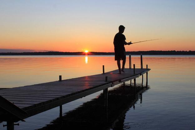 Fishing at sunrise on the cottage dock