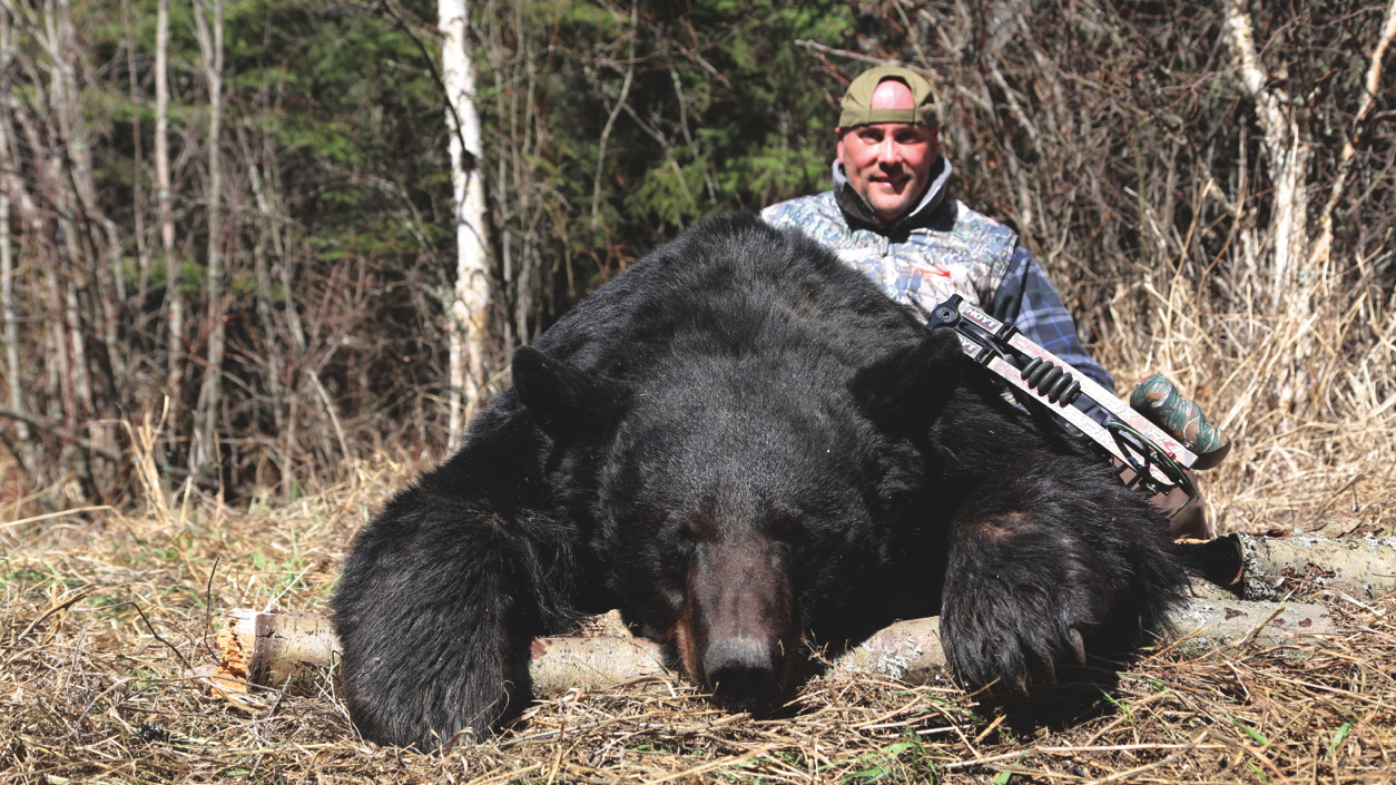 Trophy hunter Gary Gillet, with a Boone and Crockett bear that was taken over bait. Credit: Gary Gillet.