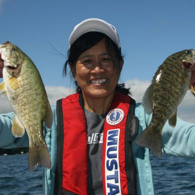 Art director Sandra Cheung with a pair of Lake Simcoe smallies