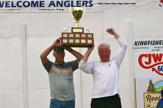 Bill Jung (left) and Doug Zwingli hoist the coveted Premiers's Walleye Cup. Credit: Michael Oleksyn.