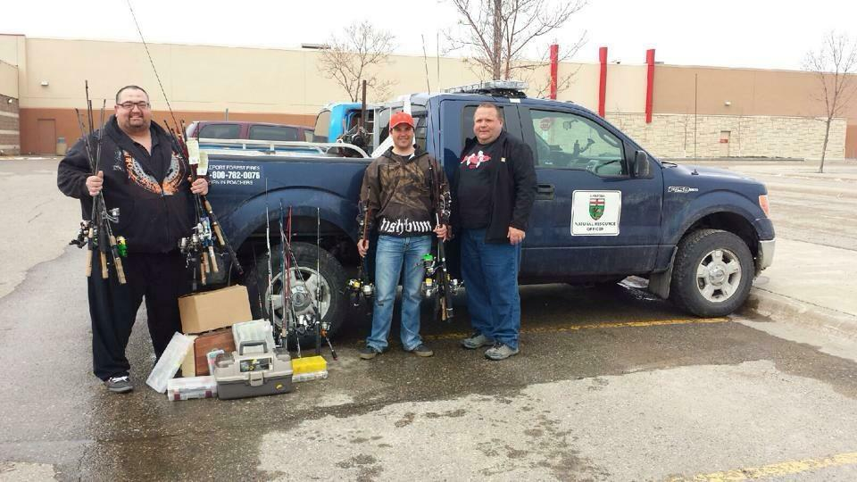 Dan Goulet (left) and Craig Ferris (right) are shown here delivering the fishing tackle donated by WAAM members to Elliott Hrychuk (centre)