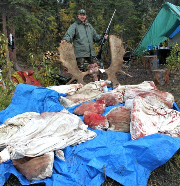 Back at camp, the author stands over the results of his successful hunt. Credit: Cody Altizer.