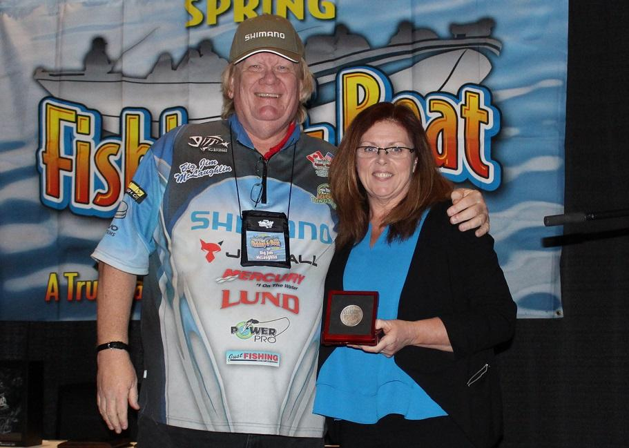 """Anger Hall of Famer """"Big Jim"""" McLaughlin (left) presented the Amsbury Award to Yvonne Brown. Credit: Outdoor Canada."""