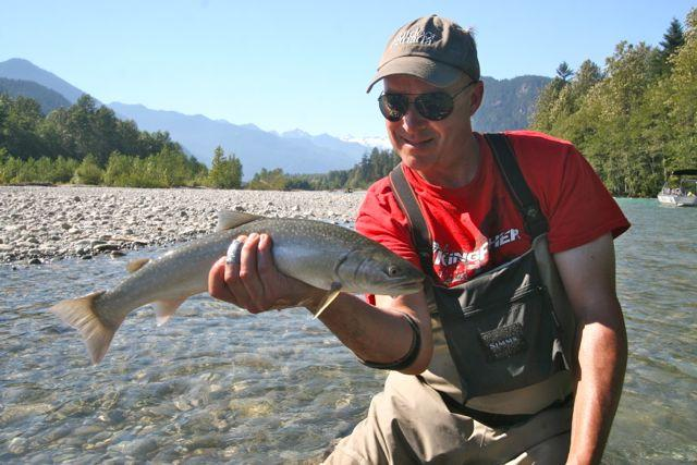 Credit: Tony Nootebos. The author and a sea-run bull trout.