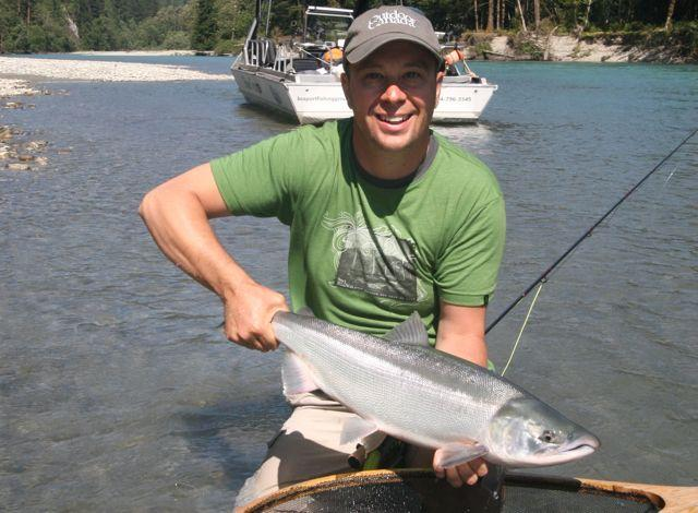 Credit: Tony Nootebos. Ted Cawkwell and a sockeye.