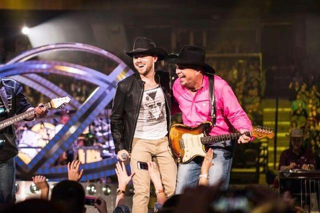 Brett Kissel (above left) perform with country music legend Garth Brooks.