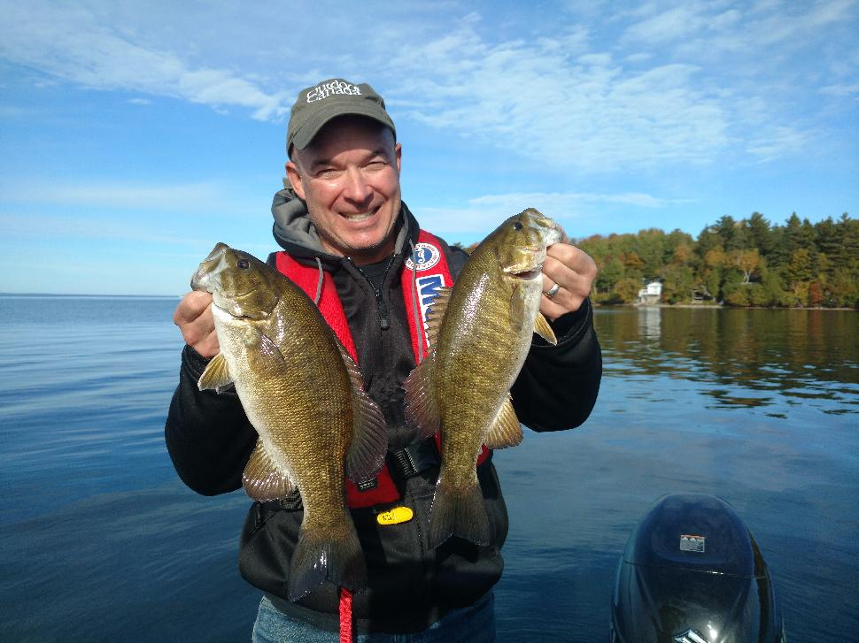 Walsh double-fists a pair of smallies he caught using a drop-shot rig in about 12 feet