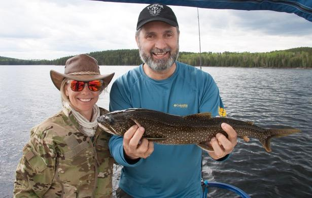 Kyla and Lawrence show off a lake trout from Ritchie Falls Resort.