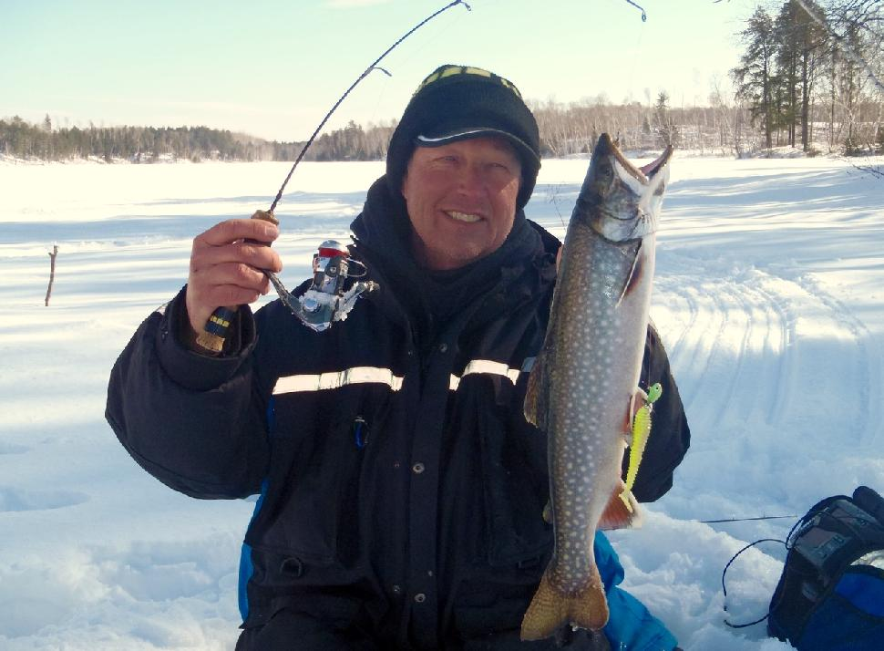 Wil Wegman works two ice rods for lake trout. Credit: Wil Wegman.